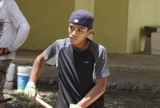 Teenager working with shovel